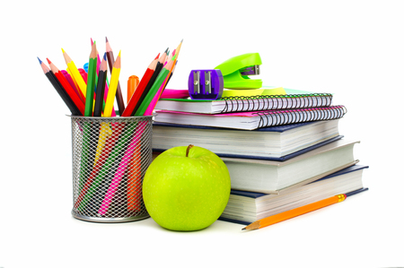Group of school supplies and books over a white background Archivio Fotografico