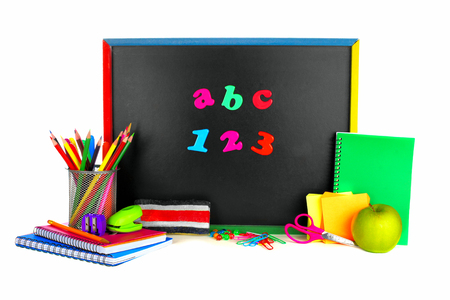 Colorful ABC 123 magnetic letters on a blackboard with school supplies photo