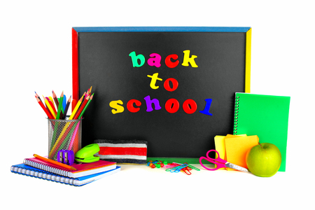 Colorful Back To School magnetic letters on a blackboard with school supplies 免版税图像