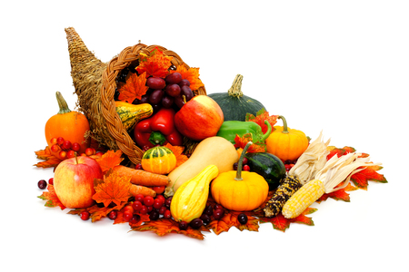 Thanksgiving cornucopia filled with fresh harvest vegetables Stock Photo