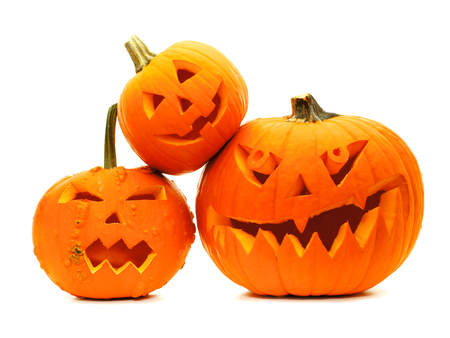 Group of varied Halloween Jack o Lanterns isolated on white