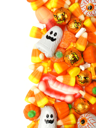 trick or treating: Halloween candy vertical border over a white background