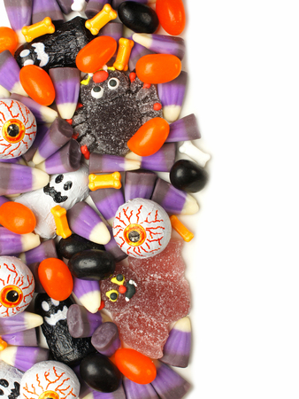 Vertical Halloween candy border over a white background photo