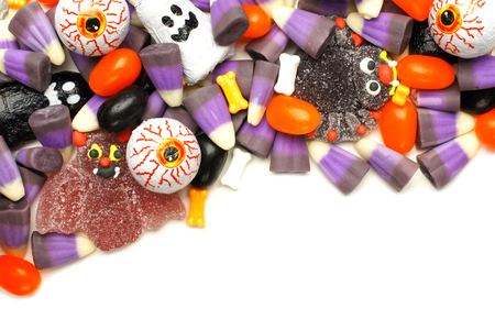 Halloween candy corner border over a white background photo