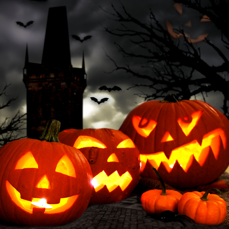 Halloween Jack o Lanterns with spooky tower and tree background