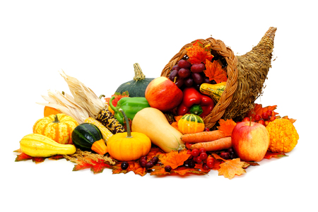 Thanksgiving cornucopia filled with fresh harvest vegetables Archivio Fotografico