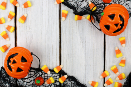 Halloween wooden background with candy corn and Jack o Lantern frame