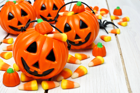 Group of Halloween Jack o Lantern candy holders with candy corn on wood photo