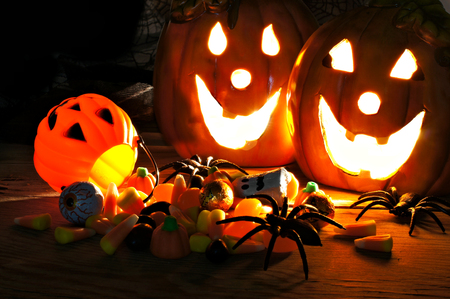 Halloween night scene with Jack o Lanterns and candy photo