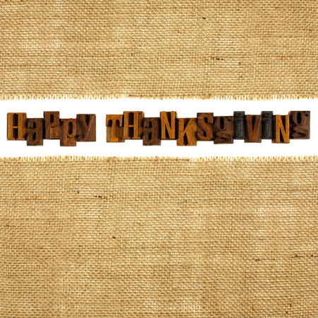 Wooden Happy Thanksgiving letterpress with burlap background photo