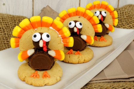 Homemade Thanksgiving turkey shaped cookies on a plate photo