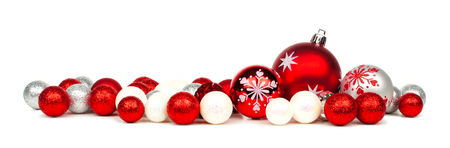 group of christmas baubles: Long Christmas border of red and white ornaments over a white background Stock Photo