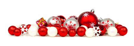 Christmas border of red and white ornaments over a white background