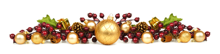 home decoration: Christmas border of gold ornaments and berry branches over white