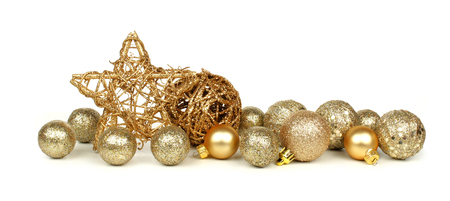 golden christmas border of stars and ornaments over a white