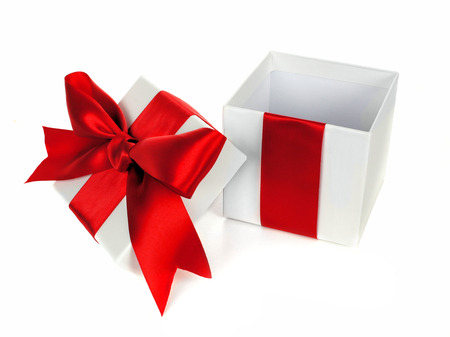 Opened white Christmas gift box with lid red bow and ribbon isolated on white photo