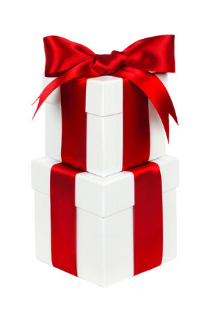 Two stacked white Christmas gift boxes with red bow and ribbon isolated on white photo