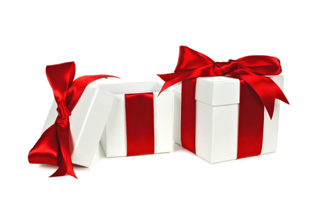 open present: Two white Christmas gift boxes, one open, with red ribbon isolated on white Stock Photo