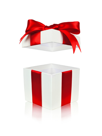 traditional gifts: Open red and white gift box with floating lid isolated on white