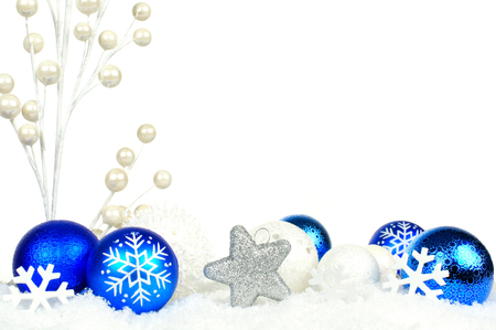 edges: Christmas corner border of blue and white branches and ornaments in snow Stock Photo