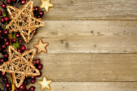 Wooden Christmas background with shiny star and branch side border photo
