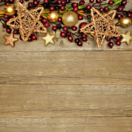 red glittery: Wooden Christmas background with shiny star and branch top border Stock Photo
