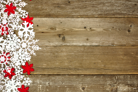 Wooden Christmas background with shiny white and red snowflake side border photo