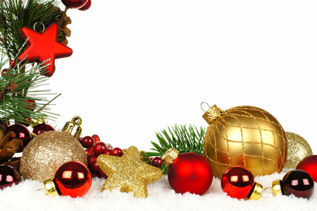 group of christmas baubles: Christmas corner border of branches with red and gold ornaments in snow