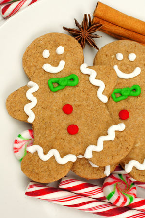 Christmas gingerbread man close up with candies and spices photo