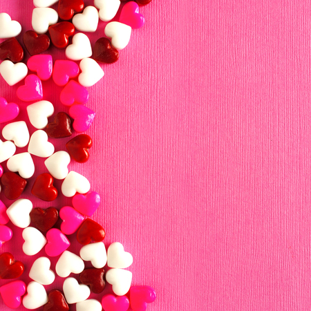 pink texture: Valentines Day candy curved border on a pink paper background Stock Photo