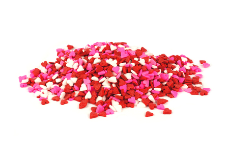 Pile of red, white and pink Valentines Day candy sprinkles hearts photo