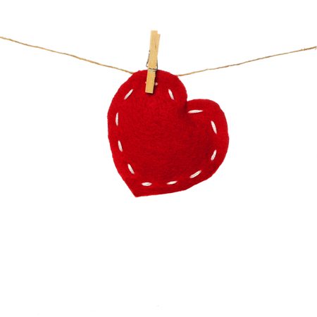 Valentines Day cloth heart on clothesline isolated on white photo