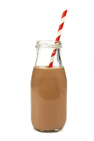 Chocolate milk with straw in a traditional bottle isolated on white