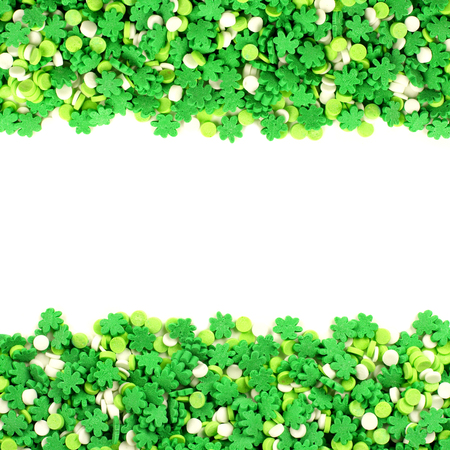 cloverleaf: St Patricks Day frame of green shamrock candy sprinkles over white