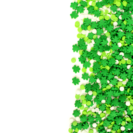 four month: St Patricks Day border of green shamrock candy sprinkles over white