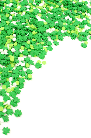 celtic shamrock: St Patricks Day corner border of green shamrock candy sprinkles over white Stock Photo