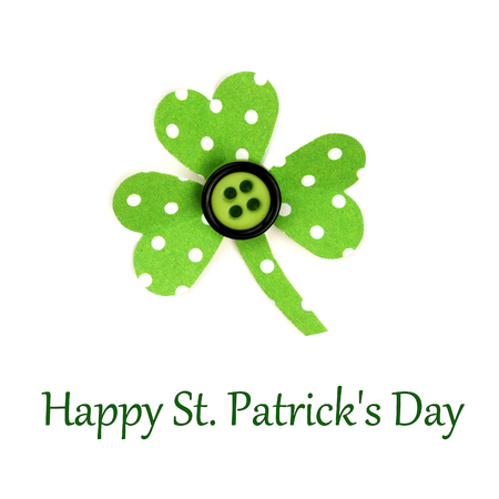 cloverleaf: Happy St Patrick Day text with handmade paper shamrock on a white background