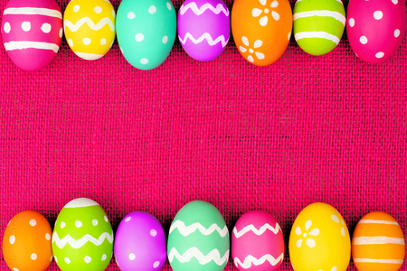 Colorful Easter egg double border over a pink burlap background