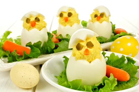 Fun Easter breakfast of hatching chicks made of boiled eggs Stock Photo
