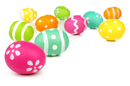 Colorful painted Easter egg border or background over white Foto de archivo