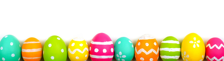 painted background: Colorful long Easter egg border against a white background Stock Photo