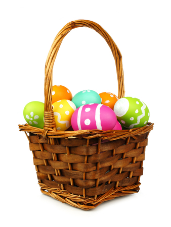 basket: Easter basket filled with colorful eggs on a white background