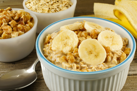 overnight: Banana walnut overnight oatmeal in a bowl on wood table Stock Photo