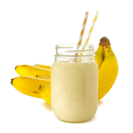 Banana smoothie in a jar with straws over white bananas in background 版權商用圖片