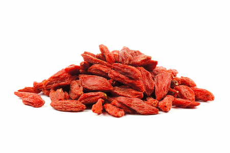 nutritional supplement: Pile of goji berries isolated on a white background side view