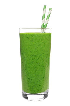 green background: Green smoothie in a glass with straws isolated on a white background Stock Photo