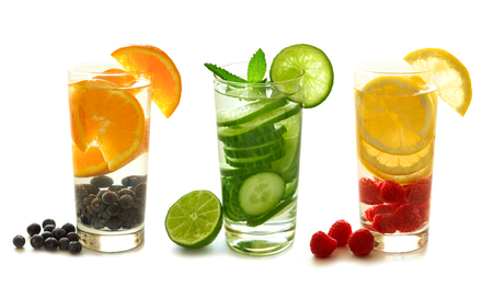 types of glasses: Three types of detox water with fruit in glasses isolated on a white background