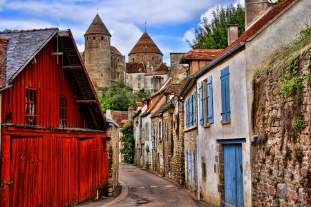 Old picturesque lane with medieval towers in the village of Semur en Auxois Burgundy France