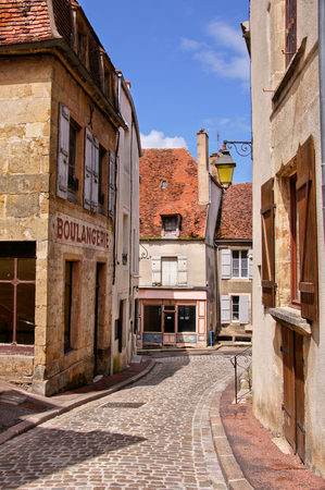 boulangerie: Cobblestone lane in a town in Burgundy France with boulangerie