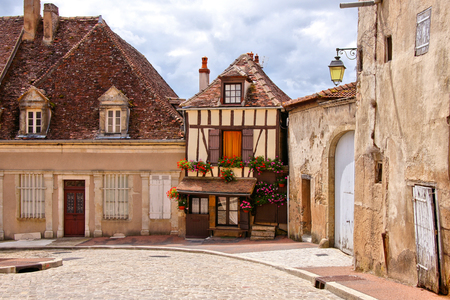 Quaint street in a town in Burgundy France with small timbered house